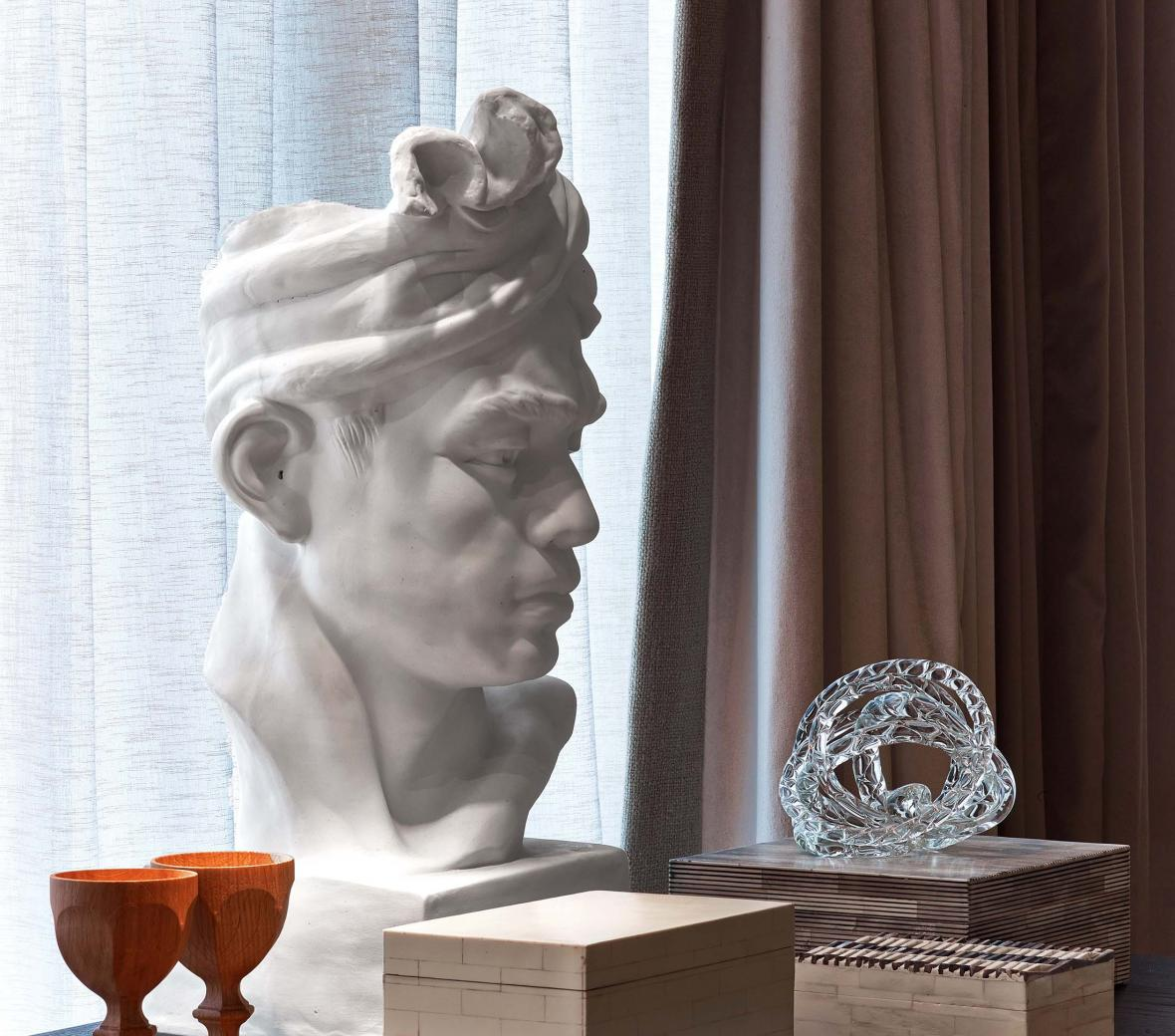 A decorative bust on a writing desk