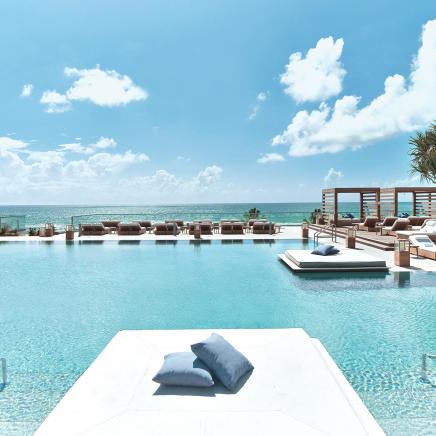 The outdoor pool at 1 Hotel South Beach overlooking the ocean