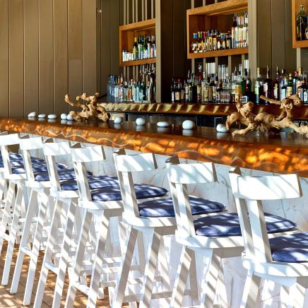 white and blue chairs along the Sandbox Bar of 1Hotel South Beach