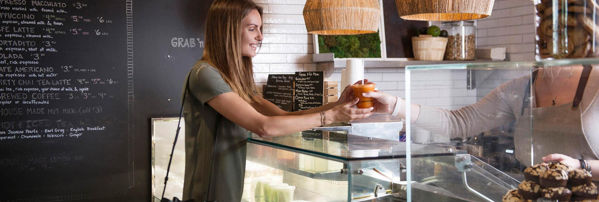 woman ordering food at neighbors cafe