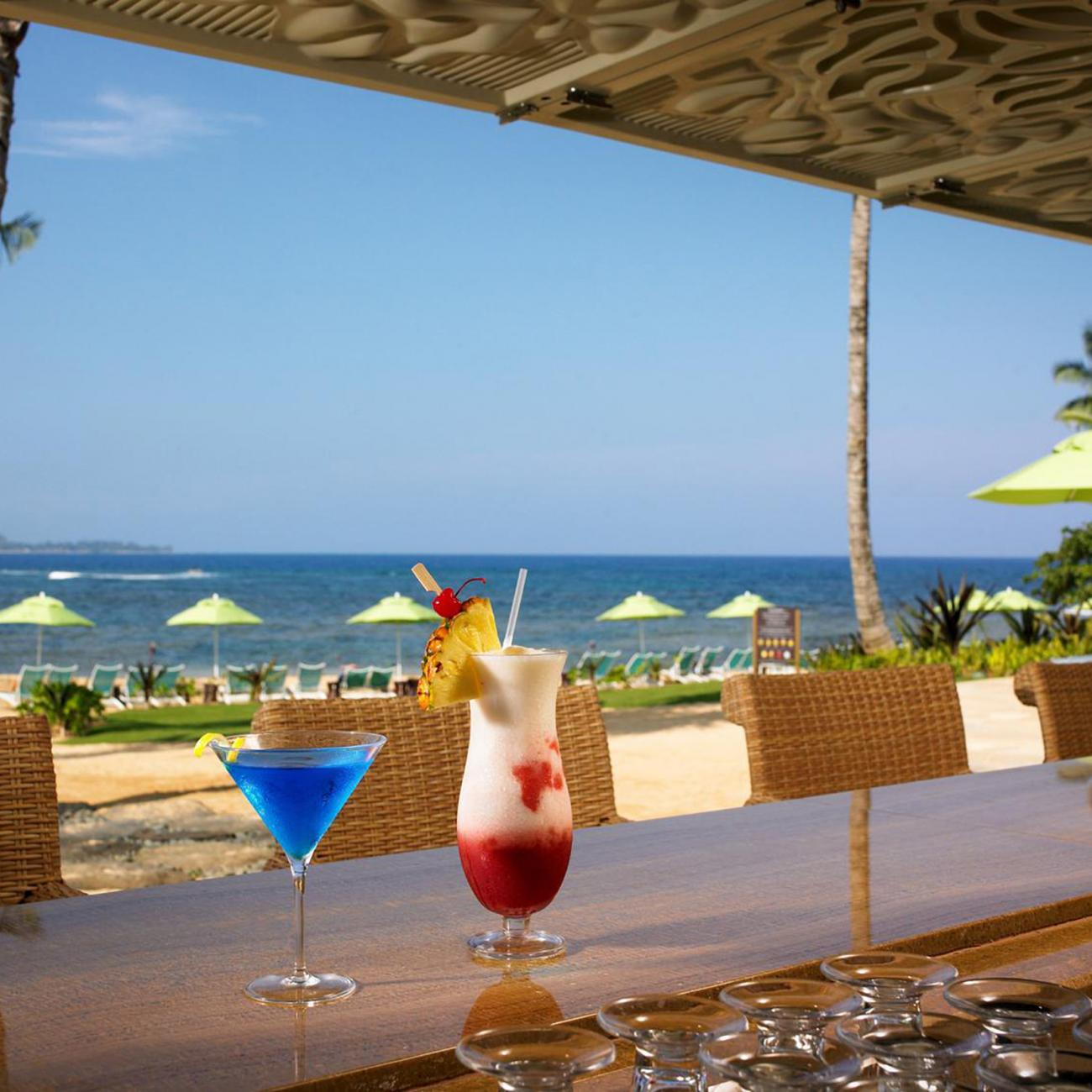 cocktails on a bar overlooking the ocean